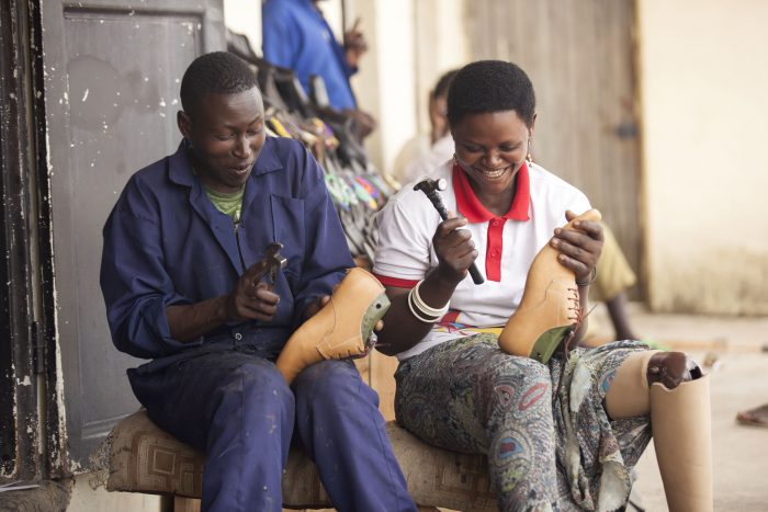 A man and a woman making shoes