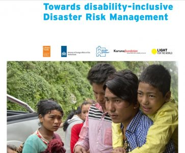 "Blue text says ""Towards disability-inclusive Disaster Risk Management"" on a white background, underneath a photo of worried looking people"