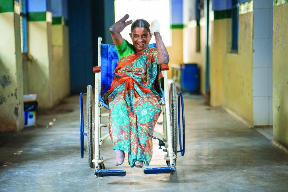 Smiling woman on a wheelchair